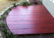 A small deck within a planting bed.