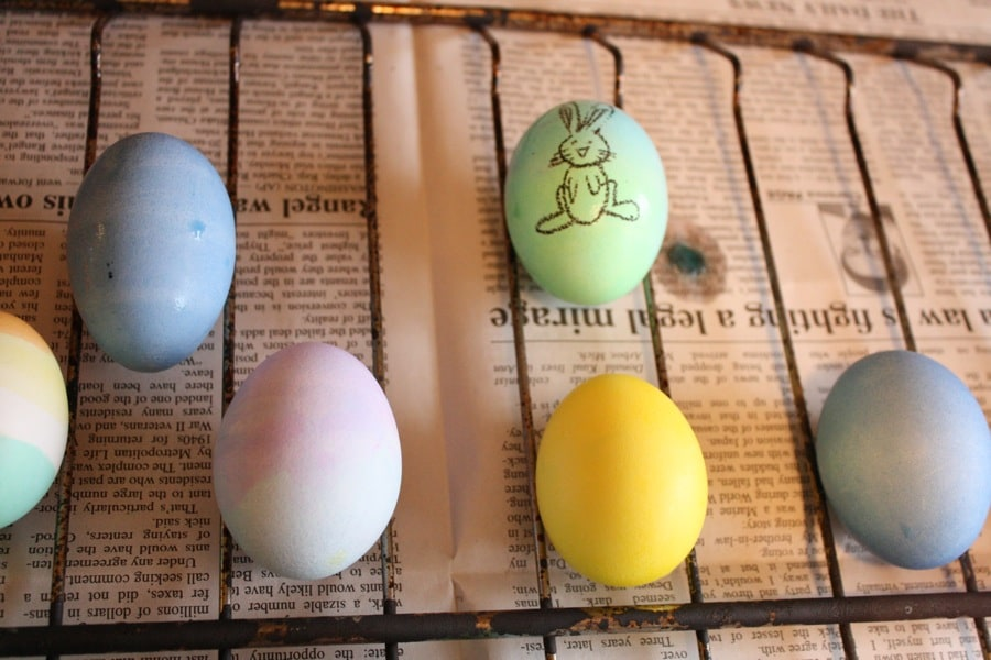 Egg-dying and drawing on the eggs with crayons.