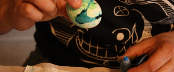 Egg-dying with direct food color application onto the egg.