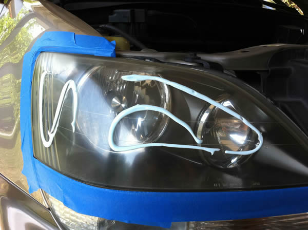 With the body around the headlight taped, you can prepare to polish