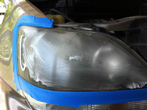 Smear the polishing compund around on the headlight so it doesn't fling everywhere when you begin with the buffing pad.