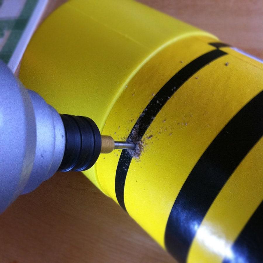 Broken Crayola Crayon Bank Bottom - drilling