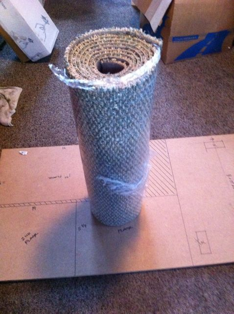 This is the carpet I bought from Home Depot. It was roughly $5 per square yard and 12 ft. long. So 1 yard by 12 ft. was plenty to cover the entire cat tree, and I had enough left over for a little doormat to my shop.