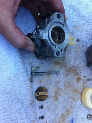 The throttle (choke) plate and shaft were still sticky, so I took that apart and was able to clean the body and venturi of the carb, as well as the plate and shaft. Careful here, you don't want to nick up the edges of the plate, shaft or lose little screws.