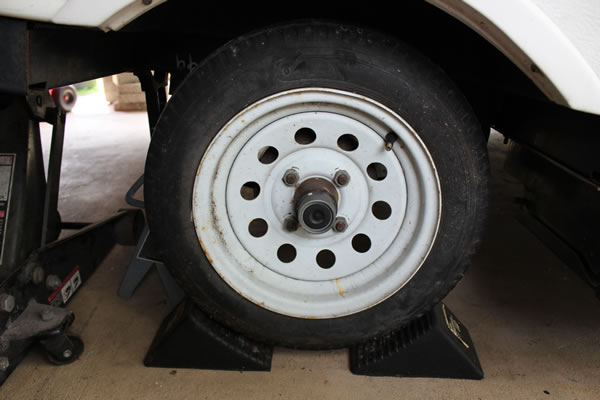 Popup camper wheel brakes are checked and wheel bearings are inspected