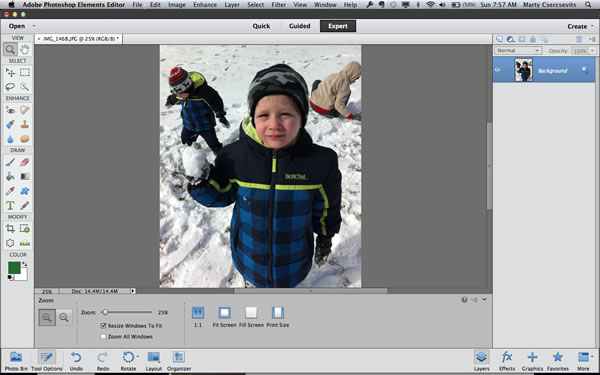 I started with a photo from the first time my kids saw snow. My son doesn't like to smile a lot in photos, but I can assure you he had fun with that snowball. Oh, and I'm using Adobe Photoshop Elements Editor to manipulate this shot.