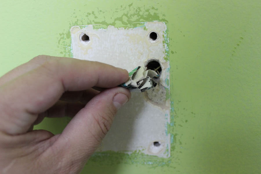 use newspaper to fill holes before spackling and painting your walls with valspar paint at Lowe's