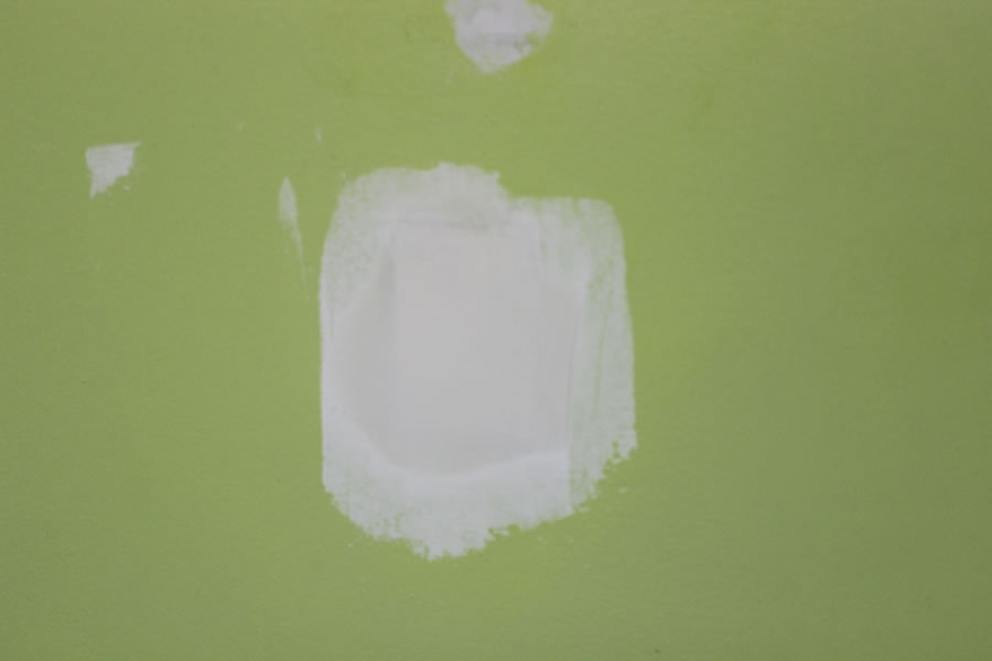 Skim walls with compound before you paint to smooth surface