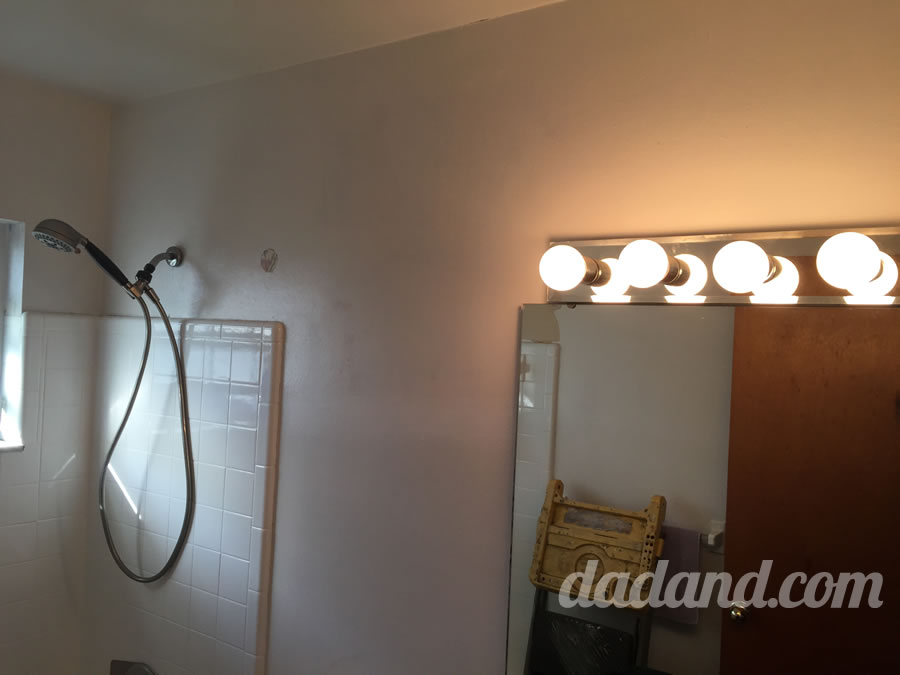 Here's a before shot. Big ugly mirror with dated light fixture…