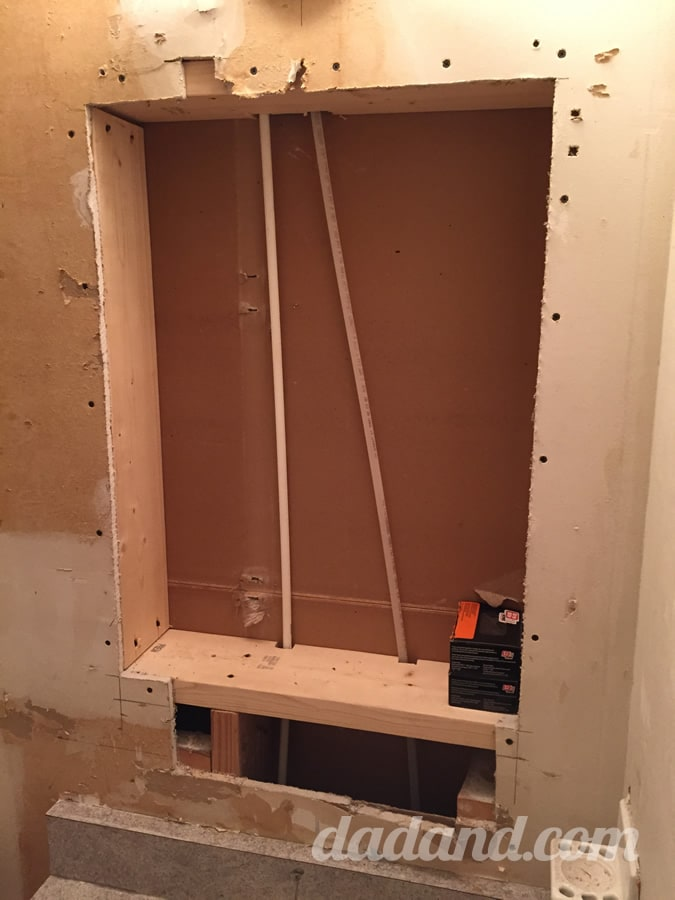 I framed in the opening for the medicine cabinet using 2x6s and had to relocate the wiring for the light fixture.