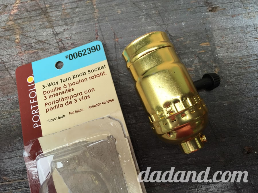 I went to the hardware store and picked up this 3-Way Turn Knob Socket. It was about $5. I'm thinking I can just use the switch with socket instead of the whole brass housing.