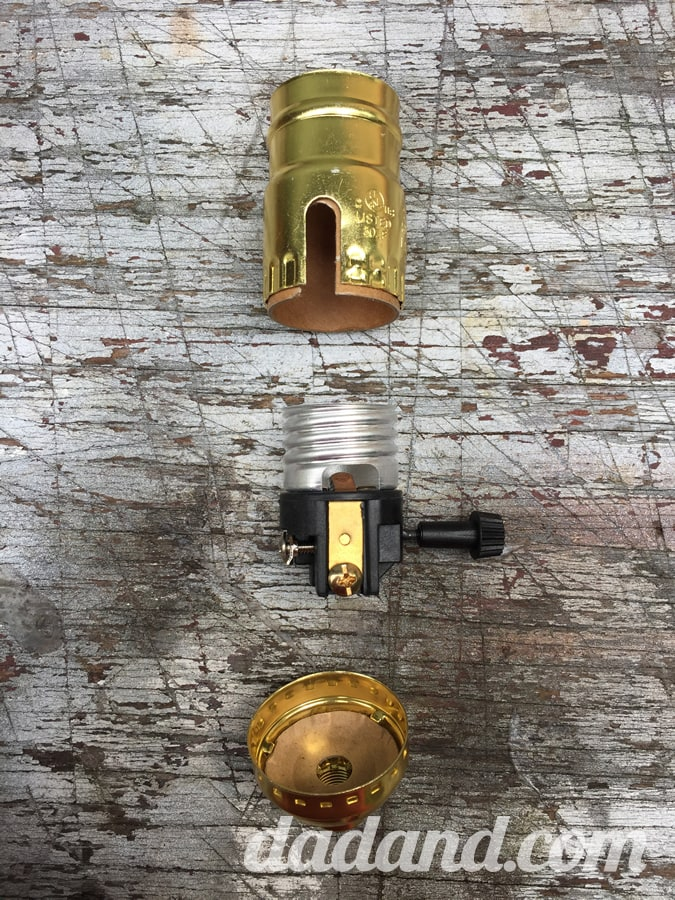 Here's the new socket assembly. I'll compare the switch against the old switch to see if it will fit in the lamp's switch housing.