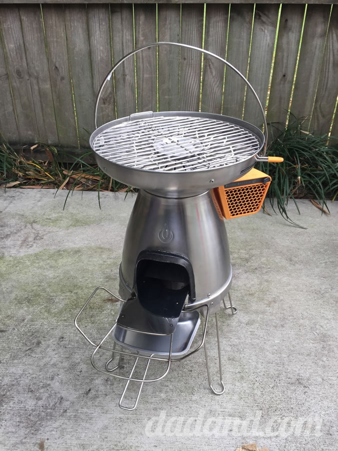 The stove is easy to carry and setup with the nice big handle at the top. Two attachments allow you to support logs feeding in to the fire and an ash pan for cleanup. It has retractable legs like a UFO.