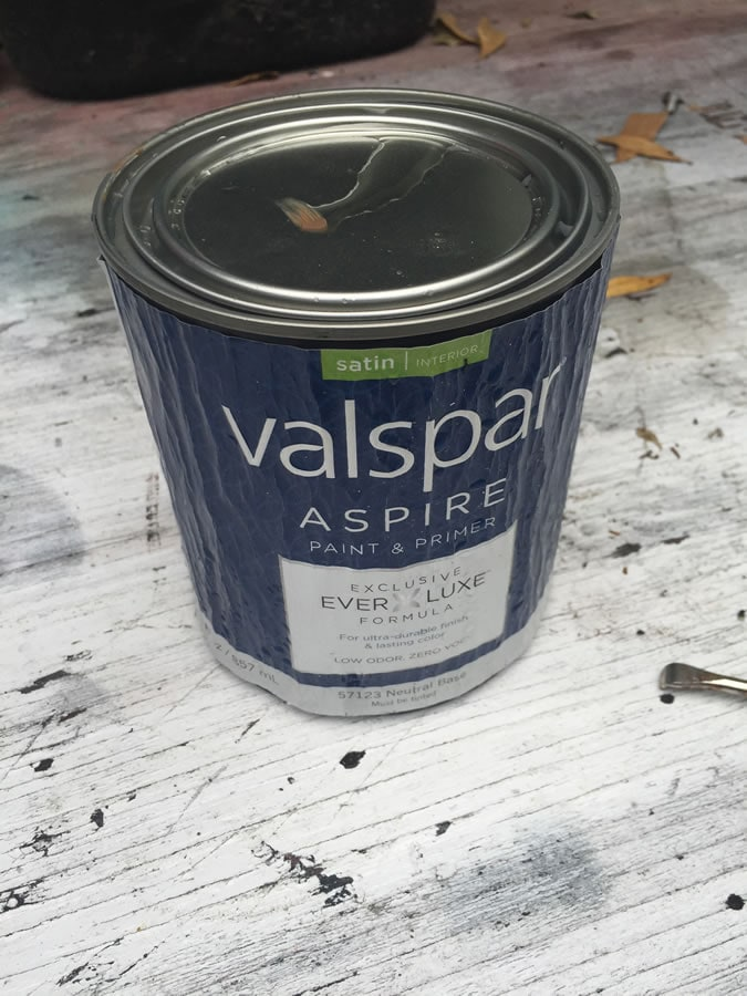 I chose the Valspar Aspire line of paint for the planter. It has the primer built in. The guy at Ace put it in the shaker for an extra two minutes because he said this paint is a little thicker than other brands and it will ensure a better mixing of the color. The paint label isn't normally wrinkly, it suddenly started pouring raining and I ran inside with my camera, leaving the paint can outside by mistake.