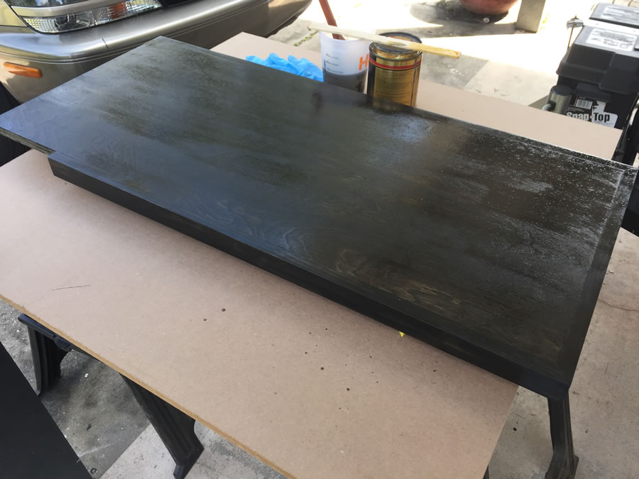 I applied an oil-based ebony colored stain to complement the other furniture in the room as well as the Valspar Rue Bourbon color. Added three coats of satin polyurethane for some protection, sanding with 220-grit in between coats.