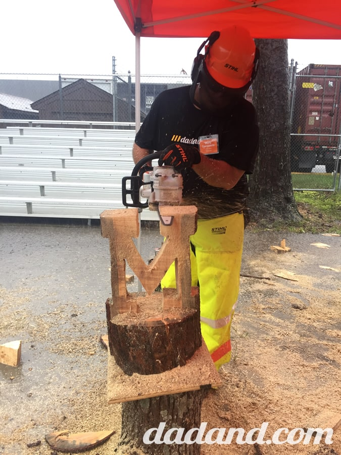 """I carved a giant """"M."""" It stood for """"monsterous downpour,"""" which is what happened just as I started carving. There was a literal river of water and sawdust underfoot moments after this was taken."""