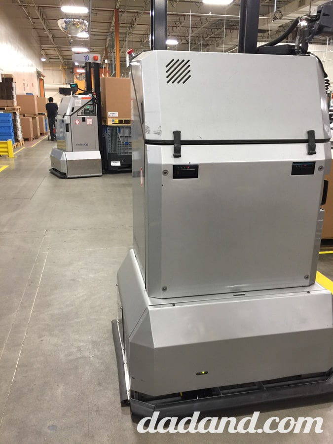 There was quite a bit of automation, but the coolest thing were these autonomous forklift robots. They were driving around everywhere, picking parts and delivering components to assembly stations. They knew where to go and had some laser-sensor-things to ensure you wouldn't get run over. The robot would just stop and patiently wait for you to move.