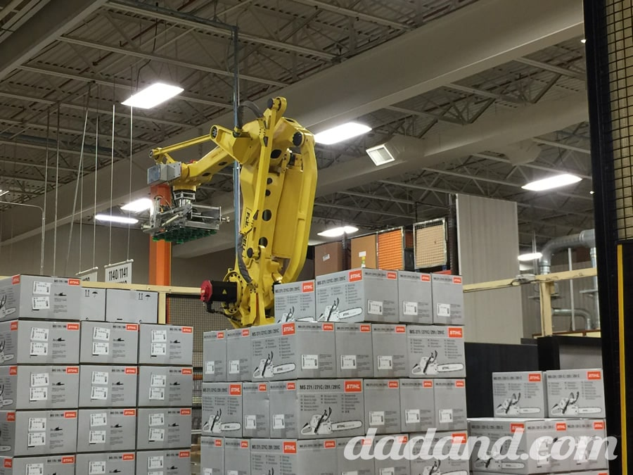 This robot, surrounded by boxed chainsaws, sits at the end of one of the chainsaw production lines and simply stacks palettes 24/7.